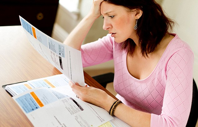 C4W4DE Woman looking at Utility bills